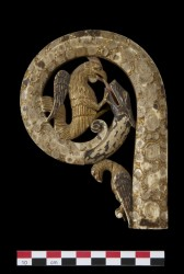 Head of crozier; ivory; volute: octagonal in section; terminating in serpent's or dragon's head; within volute: cockatrice bites monster's tongue 1150-1200